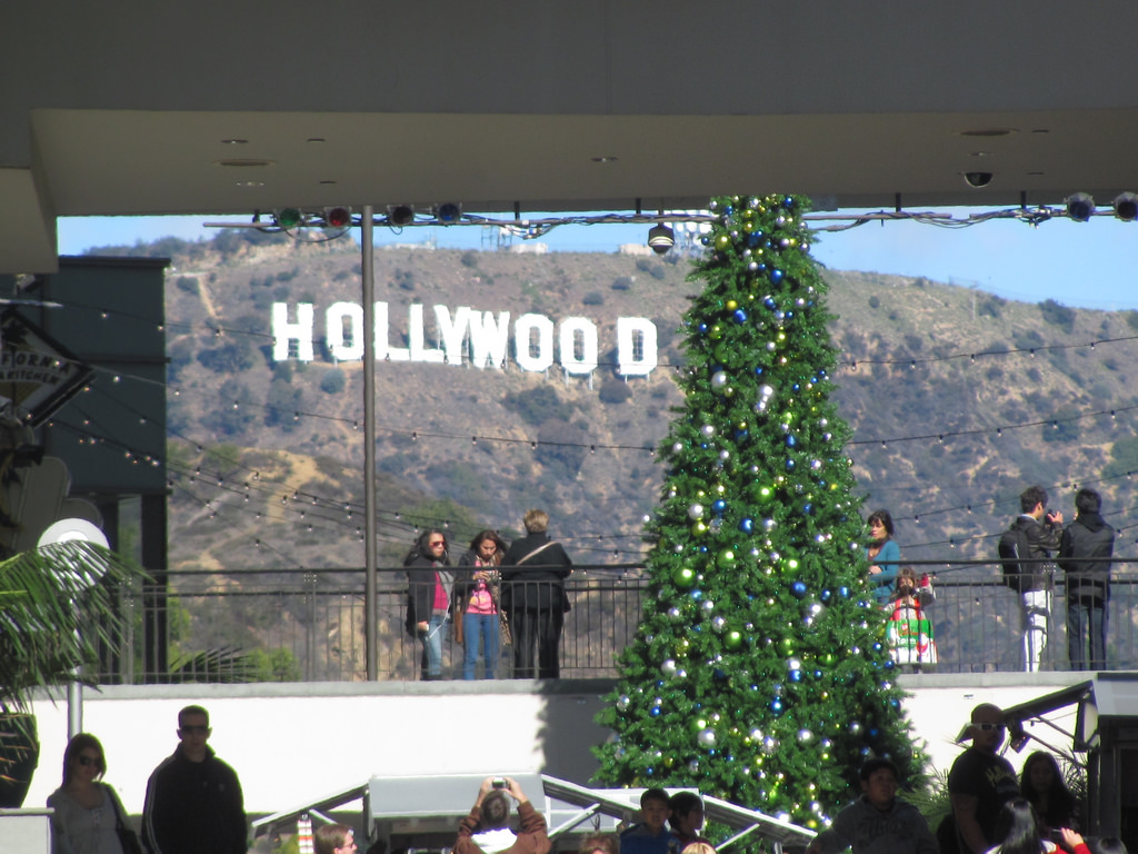 Tourists taking photos of Hollywood sign from Hollywood and Highland Center